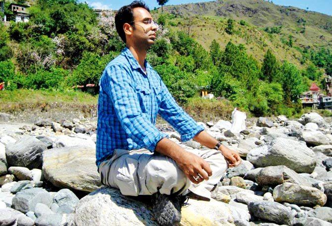 Karan Bajaj meditating in the Himalayas