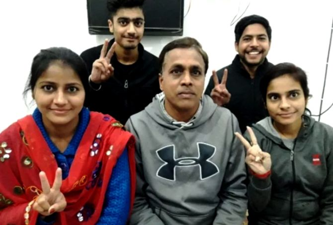 Priyam Garg's father Naresh Garg (centre) and his siblings