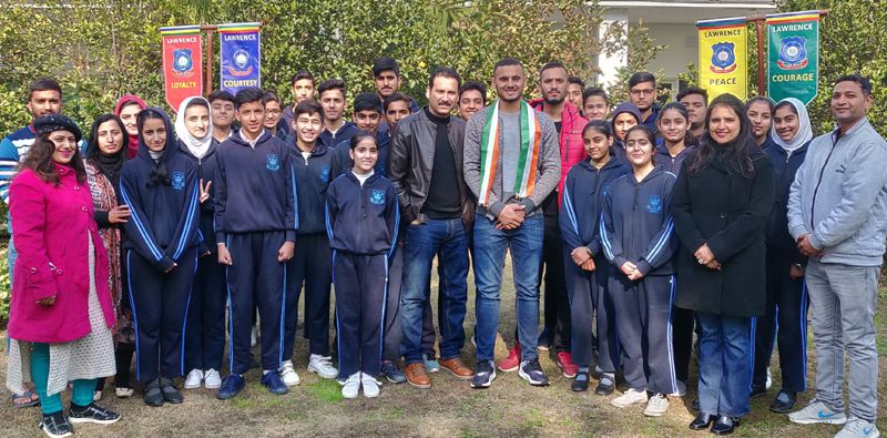 Abdul Samad standing along with students and management of Lawrence Public School