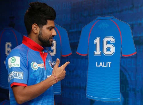 Lalit Yadav posing next to his Delhi Capitals jersey