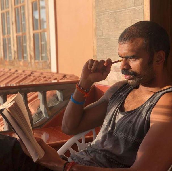 P. R. Sreejesh reading a book