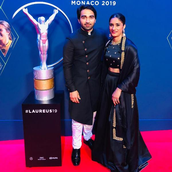Vinesh Phogat with her husband while posing at the Laureus World Sports Awards in 2019